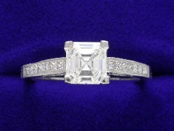 0.94 carat Asscher Cut diamond with H color and VS1 clarity in a Tacori mounting with 0.32 total carat weight of diamonds