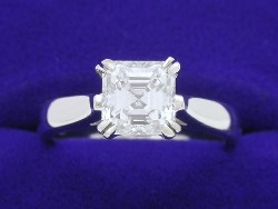 1.18 carat Asscher Cut diamond ring with H color, VS1 clarity Asscher in platinum cathedral-style mounting.