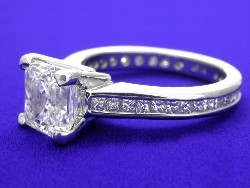 1.74 carat Asscher Cut G VS2 diamond ring with channel-set princess cut diamonds in Platinum mounting.