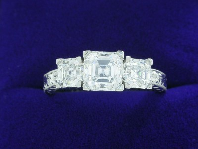 Asscher Cut Diamond Ring: 0.94 carat with 0.89 tcw Asscher Side Diamonds