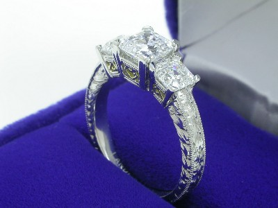 0.94-carat square emerald cut diamond set in a custom platinum Richard Landi antique mounting
