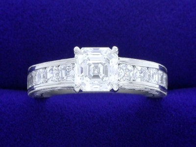 Asscher Cut Diamond Ring: 1.05 carat with 0.86 tcw Asschers in Hand Carved mounting