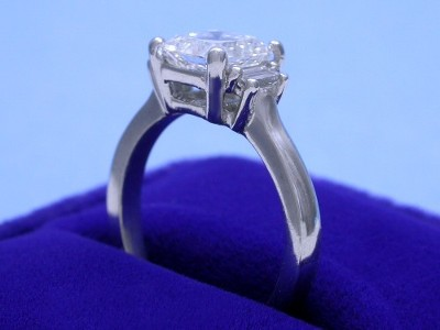 Asscher Cut Diamond Ring with Step-Cut Trapezoid Side Diamonds