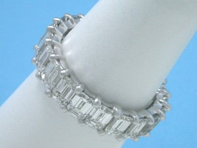 Platinum and diamond eternity band with shared prong set emerald cut diamonds