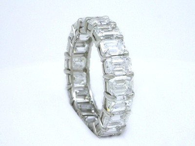 Custom platinum diamond eternity band with shared prong set emerald cut diamonds