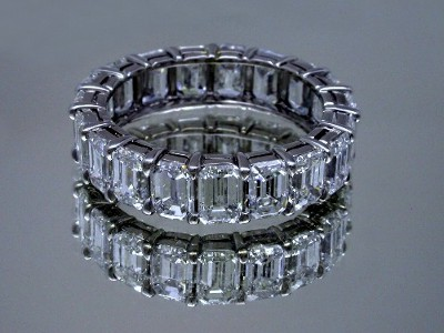 Diamond Wedding Band: 6.10 total carat weight Shared Prong Set Emerald Cut Diamond Eternity Band
