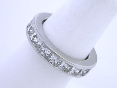 Custom diamond wedding band with 20 Princess cut diamonds with 5.06 total carat weight channel-set in platinum mounting