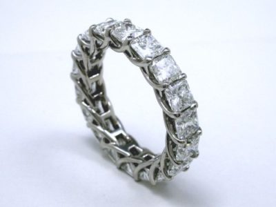 18 shared-prong set square radiant cut diamonds