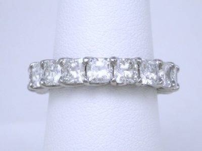 4.84 total carat weight of square radiant cut diamonds in trellis-style eternity band