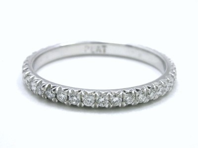 Platinum diamond eternity band with 0.39 total carat weight of round French V Split set diamonds