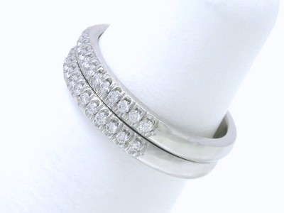 Pair of matched platinum and diamond bands with round French V Split set diamonds a little more than half way around