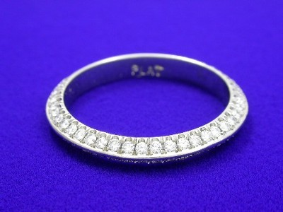 Diamond wedding band with double row of round bead set diamonds going three-fourths the way around the platinum knife-edget style band