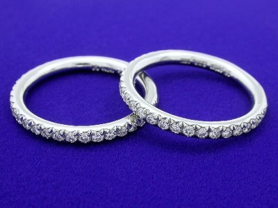 Diamond and platinum custom Bez Ambar designer French pave style wedding bands