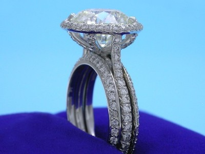 Diamond and platinum custom Bez Ambar designer Bookend style wedding bands  shown with engagement ring