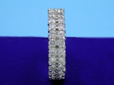 Platinum and diamond eternity band with double row shared prong set round diamonds