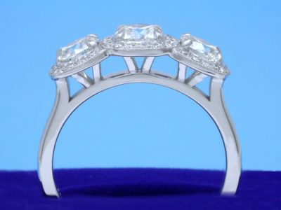 Cushion 3-Stone Diamond Ring with Modified Baskets to Accommodate Flush Fitting Wedding Band