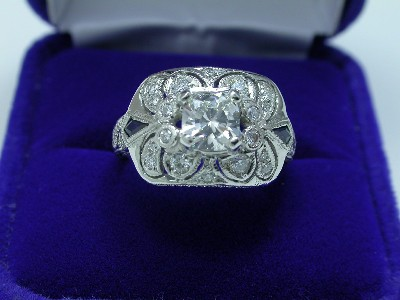 Cushion Cut Diamond Ring: 0.73 carat with 0.32 tcw pave in Richard Landi designer mounting