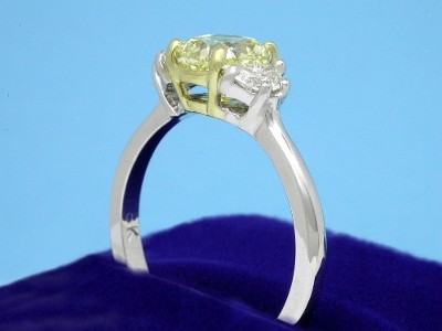 Cushion Cut Diamond Ring: 1.22 carat Fancy Yellow with 1.15 ratio and 0.34 tcw Crescent Moon Diamonds