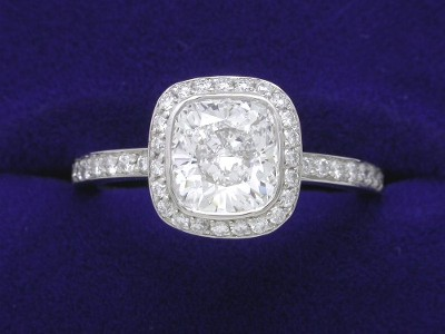 Cushion Cut Diamond Ring: 1.25 carat with 1.06 ratio and 0.35 tcw pave halo mounting