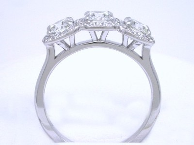 14-karat white-gold three-stone pave style mounting
