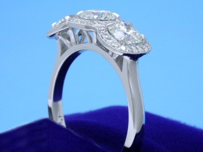 Cushion Cut Diamond Ring: 1.33 tcw 3-stone with 0.20 tcw pave Mounting