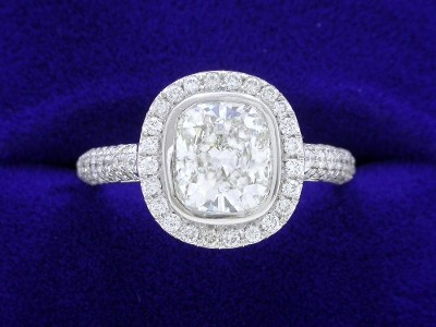 Cushion Cut Diamond Ring: 1.40 carat with 1.17 ratio and 0.66 tcw Pave Halo