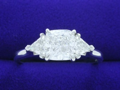 Cushion Cut Diamond Ring: 1.50 carat with 1.02 ratio in 0.41 tcw Trillion Three-Stone Mounting