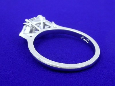 platinum three-stone mounting with modified basket-style heads