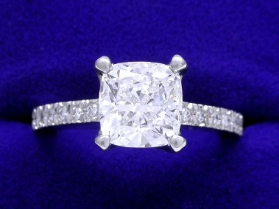 Cushion Cut Diamond Ring: 1.71 carat with 1.04 ratio in 0.11 tcw Round Diamond mounting