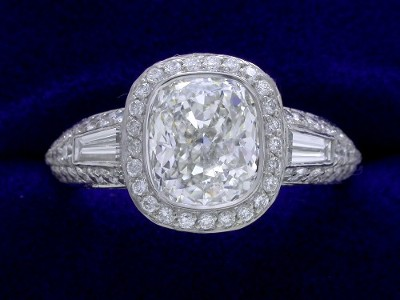 Cushion Cut Diamond Ring: 1.71 carat with 1.15 ratio 0.29 tapered baguette and 0.95 pave mounting
