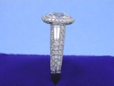 The mounting has a tapered baguette on each side of the shank (0.29 total carat weight)