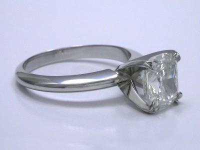 custom platinum four-prong Solitaire style mounting with split prongs