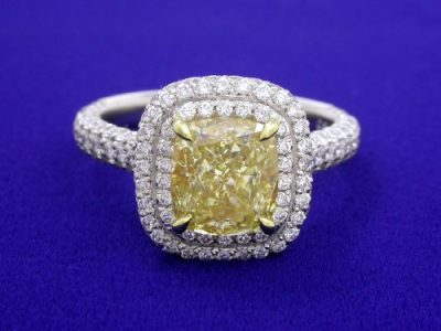 Cushion Cut Fancy Yellow Diamond Ring with 1.14 tcw Pave Halo and Shank
