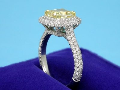 Cushion Cut Diamond Ring with Fancy Yellow Color Diamond and Pave Mounting