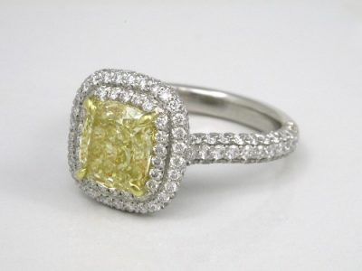 Cushion Cut Diamond Ring with Fancy Yellow Diamond Surrounded by Double Pave Halo and Pave on Top and Sides of Shank