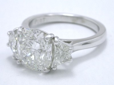 Cushion Cut and Crescent Trapezoid Diamond Ring