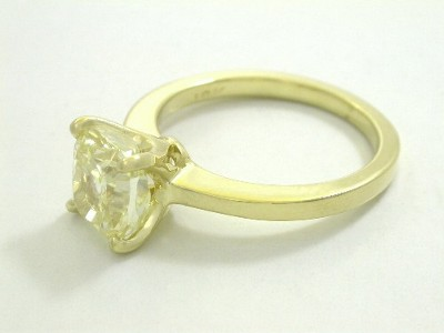 Diamond ring with a 2.38 carat cushion modified brilliant cut diamond