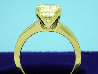 Fancy Light Yellow Cushon Cut Diamonnd