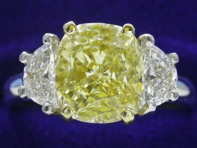 Cushion Cut Diamond Ring: 2.60 carat Fancy Intense Yellow with 1.16 ratio with 0.70 tcw Half Moon diamonds