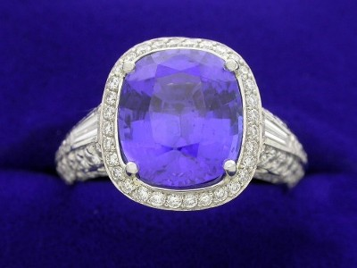Cushion cut Tanzanite and diamond ring with Bez Ambar designer mounting featuring tapered baguettes and pave on the halo and shank