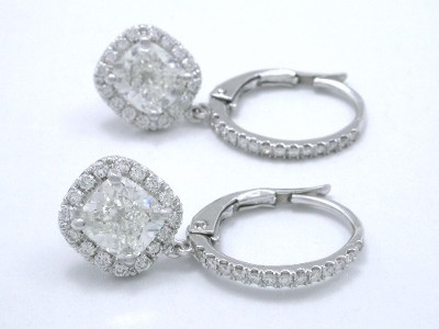 Cushion cut diamond earrings with pave frame and pave on the front of the lever backs
