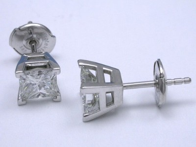 Princess cut diamond earrings prong set in basket style mountings with clutch backs