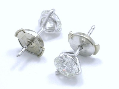 Round brilliant cut diamond earrings with three prong Martini style heads and clutch backs