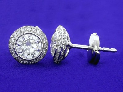 Round brilliant cut diamond earrings with Bez Ambar designer knife-edge pave mountings and clutch backs