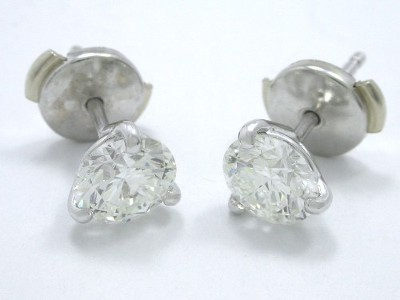 Round brilliant cut diamond earrings with three prong Martini style mountings and clutch backs