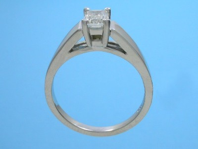 Diamond ring with 0.72 carat emerald cut diamond