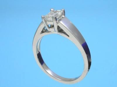 Emerald Cut Diamond in Cathedral-Style Mounting