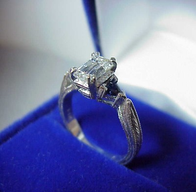 Emerald Cut Diamond Ring: 0.82 carat with 1.50 ratio and 0.26 tcw Blue Sapphire Trillions