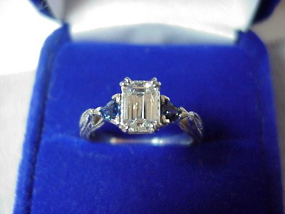 0.82 carat emerald cut diamond graded E color, VS1 clarity