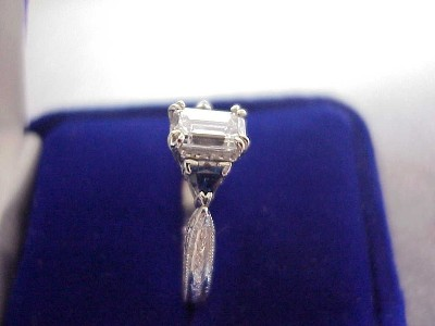 Diamond ring with 0.82 carat emerald cut diamond